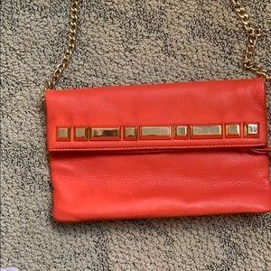 Vince Camuto orange clutch
